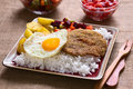 Bolivian dish called silpancho traditional which is the name of the breaded flat round piece of beef meat served with fried egg Stock Image