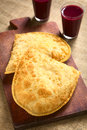 Bolivian pastel with api traditional a deep fried pastry filled cheese which is a popular street snack served a purple corn Stock Photo