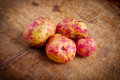 Bolivian potatoes on wooden table Stock Photography