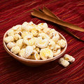 Bolivian snack pasancalla sweetened popped white corn called eaten as in bolivia served in a clay bowl photographed with natural Stock Photos