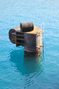 Bollard with bumper for mooring ships in port Stock Photo