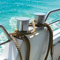 Bollard with coiled rope Royalty Free Stock Photo