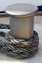 Bollard a with mooring line Royalty Free Stock Images