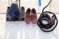 Bollard with nautic shoes and rope coil Royalty Free Stock Image
