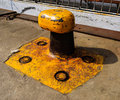 Bollard on the pier an old a under sun in a bright day Stock Photo