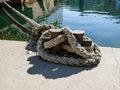 Bollard with a rope on marina pier black sea balaklava bay crimea Stock Photos