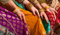 Bollywood dancers holding their vivid costumes hands row Royalty Free Stock Images