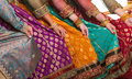 Bollywood dancers holding their vivid costumes hands row Stock Photography