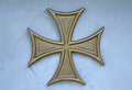 Bolnisi gilded cross on the blue wall Royalty Free Stock Photography