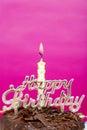 Bolo de aniversário com vela com fim do sinal acima Fotografia de Stock Royalty Free