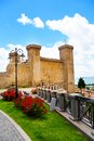 Bolsena castle and flower beds square in front of it located in lazio itally with red flowers in front of it Royalty Free Stock Photos