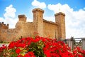 Bolsena castle in spring flowers and square front of it located lazio itally with red on foreground Stock Images