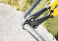 Bolt cutter bites electric cabel Royalty Free Stock Photo