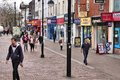 Bolton uk april people walk along a shopping street on april in is part of greater manchester one of largest Royalty Free Stock Images