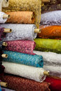 Bolts rolls of various colored fabric a background Stock Photos