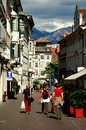 Bolzano italy pedestrians only walking street people along a lined by handsome th century tyrolean buildings in Stock Photography