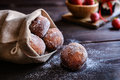 Bomboloni - Italian doughnuts stuffed with strawberry jam Royalty Free Stock Photo