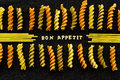 Bon appetit page spelled by pasta on black message arranged using fabric Stock Images