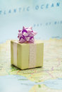 Bon voyage gift wrapped on europe map Stock Image