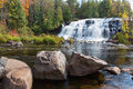 Bond falls in autumn upper peninsula of michigan paulding is surrounded by vivid colors state park can be found the Stock Photography