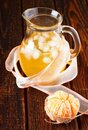 Bonded mandarin and jar with cold drink vertical photo of fruit pieces of ice cubes inside single by cord is in Stock Photos