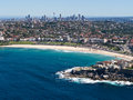 Bondi beach and sydney skyline the including the harbour bridge taken from a sea plane Royalty Free Stock Images