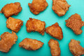 Boneless chicken wings on teal surface Stock Photography