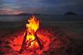 Bonfire on the beach at night Stock Images