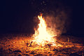 Bonfire the bright big burns on a beach at night Royalty Free Stock Photo