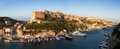 Bonifacio fortifications and harbor corsica france marina with sailing yachts at sunrise Stock Photo