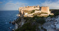 Bonifacio in morning sun corsica france fortification with blue sea and wild coast Royalty Free Stock Image
