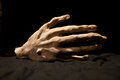 Bony hand an artificial as a decoration or for theater Royalty Free Stock Photo