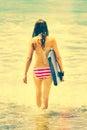 Boogie board girl bikini carrying Royalty Free Stock Photos