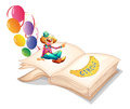A book with a clown and balloons illustration of on white background Stock Photo
