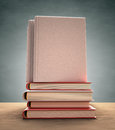 Book cover several books over the table your text or image on the clipping path included Royalty Free Stock Photo