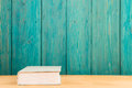 book on the desk over wooden background Royalty Free Stock Photo