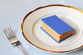 Book for dinner blue on white chinaware and a fork Stock Photo