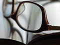 Book with glasses open pages and eyeglasses in close Stock Images