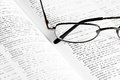 Book and glasses opened russian serbian dictionary with eye Royalty Free Stock Photography