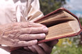 Book in a hand female holding an old concept of reading and knowledge outdoor shot with particular focus on the and Royalty Free Stock Photography
