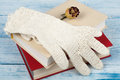 book, hardback books on wooden table, rose and white gloves knitted crochet Back to school. Copy space for text. Royalty Free Stock Photo