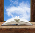 Book heart shape page open window sky Royalty Free Stock Photo