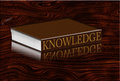 Book of knowledge on wood Stock Photos
