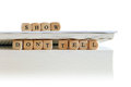 Book with message show don t tell for creative writing spelled wooden letter blocks on the top and between pages of a big white or Stock Image