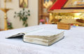 The book with the prayers on the table of church Stock Photo