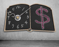 Book shape blackboard with clock hands and money symbol drawing on wall Royalty Free Stock Image