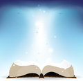 Book and shine open on a blue background Royalty Free Stock Images