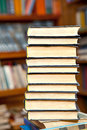 Book stack and shelfs in a library Stock Photography