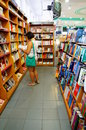 Book store woman checking a at a empik in poznan poland Stock Photography