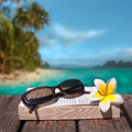 Book and sunglasses tropical beach background Stock Image